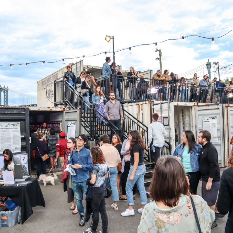 PP11PT New York, USA. 22 September 2018. Viewers move through photography exhibits at the seventh annual Photoville event September 22, 2018 below the Brooklyn Bridge in Brooklyn New York. Photoville exhibits the work of over 600 visual artists displayed in 65 shipping containers for two weeks.  Credit: Brazil Photo Press/Alamy Live News